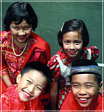 Four children of three different races from Singapore
