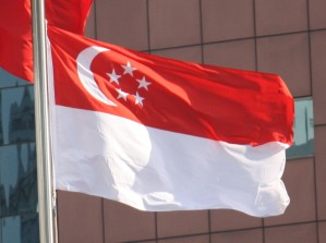 The Singapore flag - red and white with 5 stars