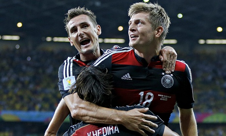 Miroslav Klose, left, Toni Kroos, right, and Sami Khedira, all first-half scorers for Germany, celebrate during the battering of Brazil.