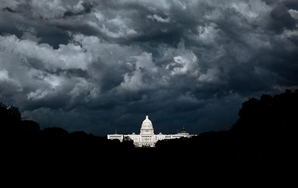 Picture of the White House with storm clouds hovering over it
