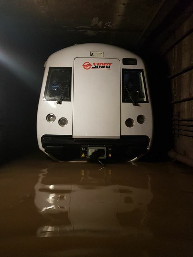 An SMRT train sits stranded in a flooded tunnel, 2017